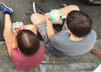 kids eating shave ice top view
