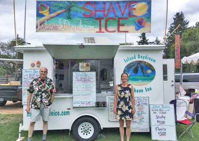 owners with island daydream shave ice trailer