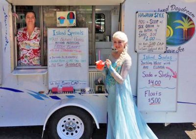 princess in front of shave ice trailer